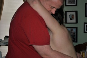 Us during labor. We are standing, I'm leaning against him, arms around his neck.