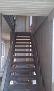 Outdoor wooden staircase leading to our old apartment