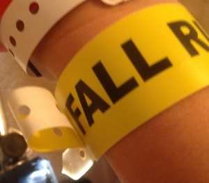yellow wrist band with Fall Risk in bold, black capital letters.