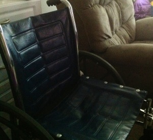 My wheelchair, blue leather, black and gray wheels, foot rests and handles.