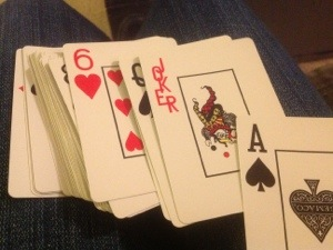 photo of playing cards fanned out on my lap