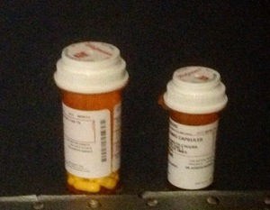 two pill bottles on a table