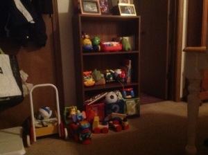 bookshelf full of toys