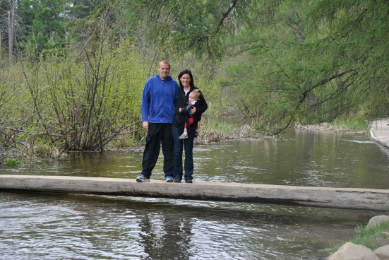 The three of us standing on a log over the Mississippi River's source in Minnesota