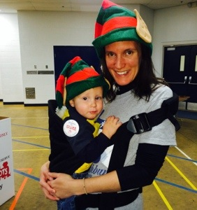 Michaela and the Little Guy in elf hats during a Toys for Tots donation day.