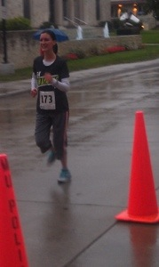 Michaela crossing the 5K finish line